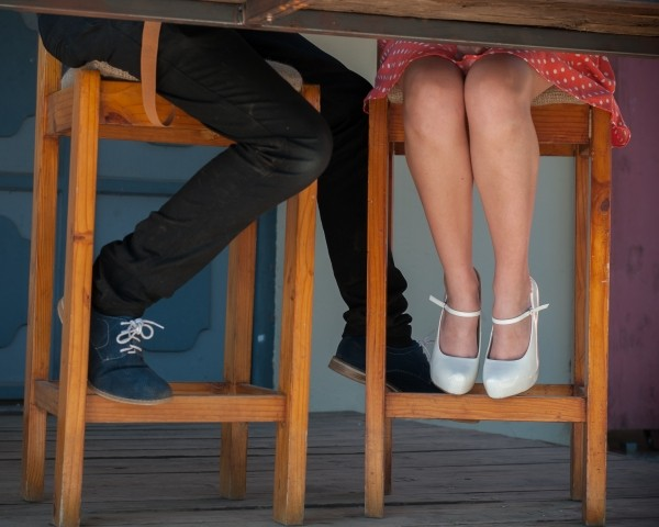 2-couple-sitting-in-wooden-chairs